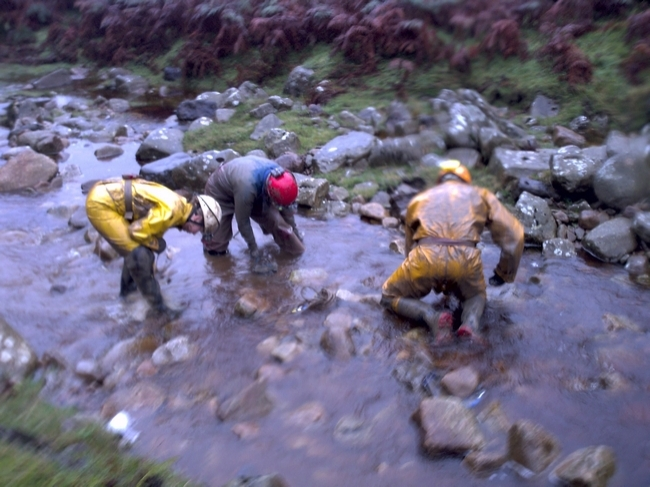 Washing off in the now-swollen Easegill Beck