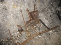 Mining tools left at a bothy on the 40 yard level.  The enamelled can still contains a liquid.