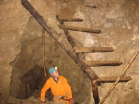 Steve looks up at a miners' improvised staircase.